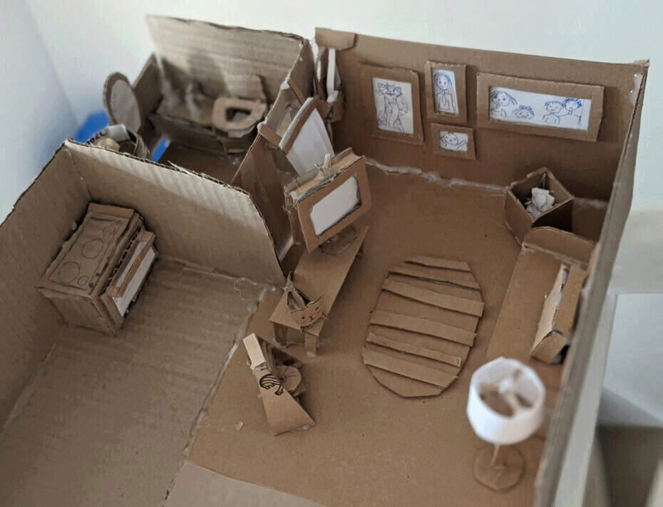 a homemade cardboard sculpture of a house
